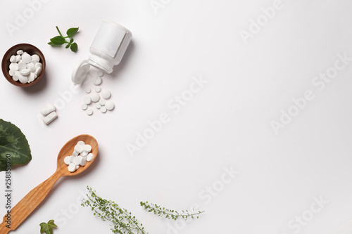 Composition with plant based pills on white background Canvas Print