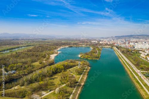 Foto op Aluminium Kust Zagreb, Croatia, Jarun lake, beautiful green recreation park area, sunny spring day, panoramic view from drone, city in background
