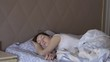 Young woman wakes up in bed a healthy dream