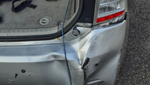 A Toyota Prius In Metallic Gray Was Damaged.