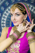 Woman in indian clothes dancing belly dance. Young beautiful woman in national costume dancing tribal dance.