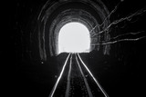Train tunnel. Old railway in cave. Hope of life in the end of the way. Railroad of locomotive train in Thailand. Old architecture. Railway tunnel built in 1914. Travel and hope at the destination.