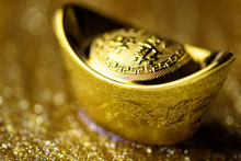 Chinese Gold Ingot On Gold Bac...
