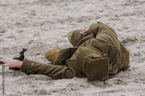 RECONSTRUCTION OF THE BATTLE FROM SECOND WORLD WAR - A Polish soldier, injured in a fight, is waiting for help