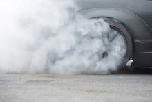 Racing Car Burning Rubber Tire...