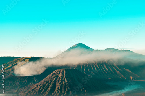 Poster Turquoise Beautiful colorful sunrise over Mount Bromo and wild island in Mount Bromo National Park