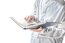 Muslim Man Standing While Read...