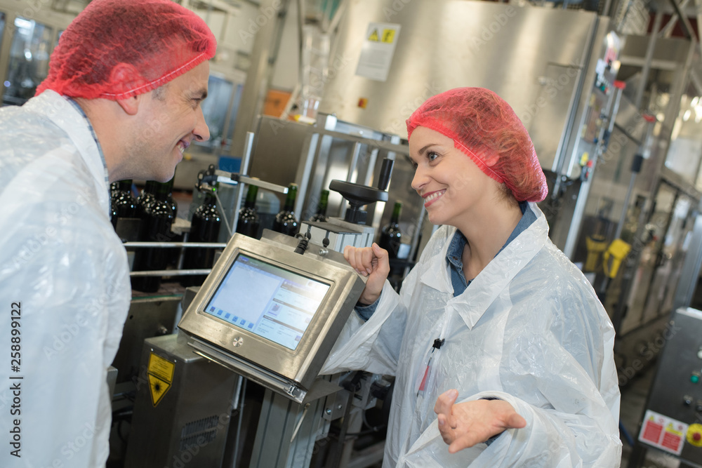 Fototapety, obrazy: man and woman wearing hair nets making notes on clipboard