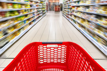 Red Empty Shopping Cart In A Supermarket Aisle With Nobody, Motion Blur