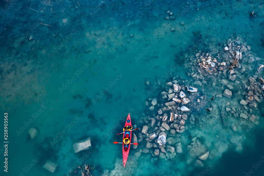 Fototapety, obrazy: two athletic man floats on a red boat in river