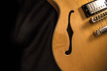 Vintage Archtop Guitar In Natural Maple Close-up From Above On Black Background, F-hole Detail