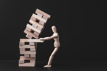 Business Project. Strategy Mistake. Risk And Failure. Falling Tower Stack. Conceptual Articulated Mannequin Composition.