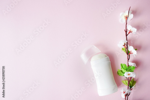 antiperspirant or deodorant with white flowers on pink pastel background Wallpaper Mural