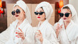 Urban women lifestyle. Care and luxury. Self assurance faces. Champagne in hands. Sunglasses, bathrobes and turbans on.