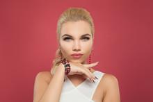 Elegant Woman In Gold Earrings And Bracelet