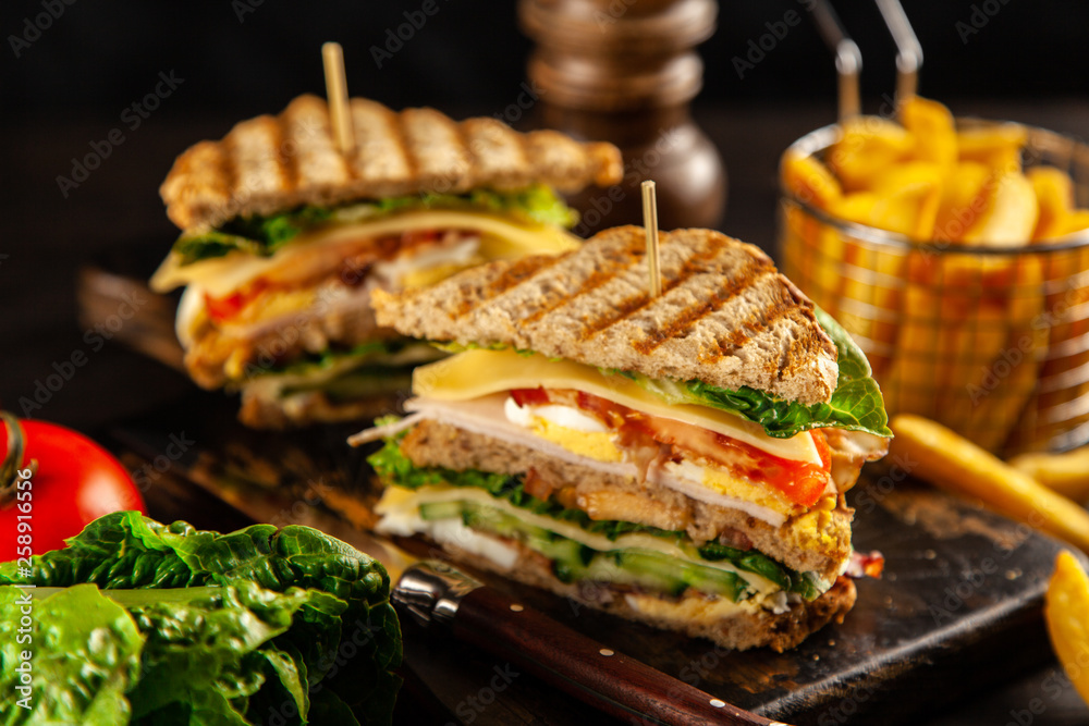 Fototapeta Tall club sandwich and french fries