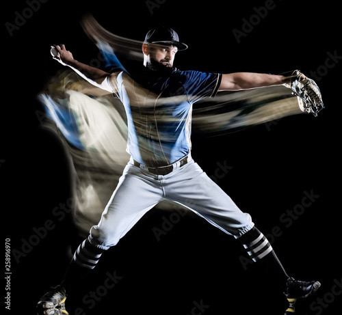 Fototapeta one caucasian baseball player man  studio shot isolated on black background with light painting speed effect obraz