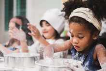 Group Diversity Kids Girl Making Cake Bakery In Kitchen