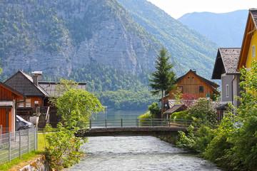 Fototapeta na wymiar View of houses in Hallstatt village from lake Hallstater See in Alps. Austria. Popular tourist destination.