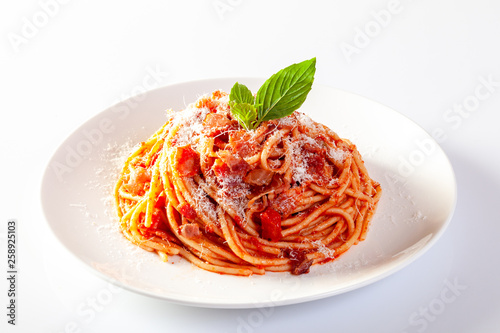 Spaghetti in a dish on a white background Fototapeta