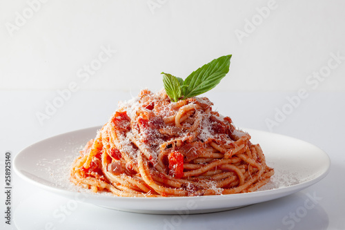 Foto Spaghetti in a dish on a white background