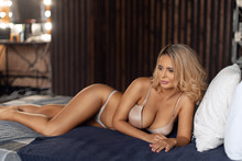 Sexy Girl With A Beautiful Figure In Lingerie Relaxes On The Bed