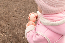 Little Girl Holds Chicken Eggs In Hands. Easter Time. Place For Text.