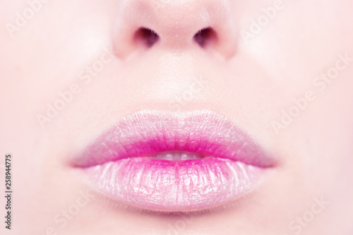 Foto op Plexiglas Beauty Lips close up. Lips with a delicate pink makeup.