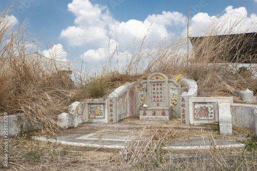 Abandoned Chinese tombstone © Voradech Triniti