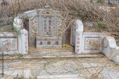 Close up Abandoned Chinese tombstone © Voradech Triniti