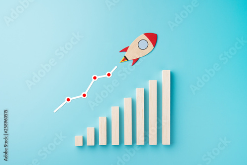 Rocket and chart on blue background business financial start up growth success c Fototapet