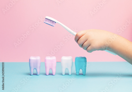 Fotografie, Obraz  Toothbrush and big tooth on blue and pink background