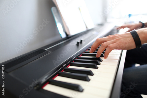 Male musician hands playing modern electric piano Canvas Print