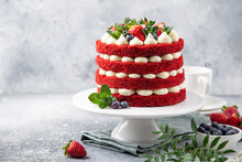 Festive  Red Velvet Cake On White Cake Stand