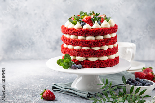 Fototapeta festive  Red Velvet cake on white cake stand