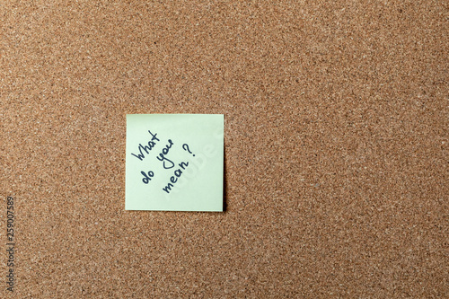 green sticker on brown table Wallpaper Mural