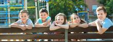 Five Children Sitting On Bench