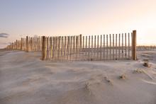Sand Dune, Fence, And Sky Glow...