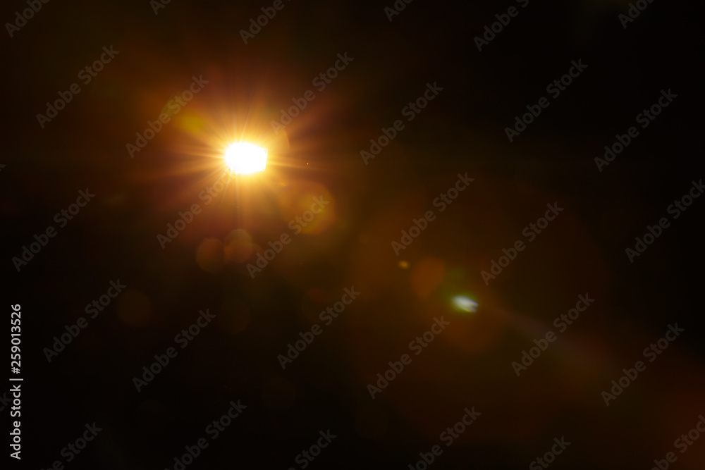 Fototapety, obrazy: Abstract Natural Sun flare on the black background.