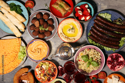 Tuinposter Grill / Barbecue Middle eastern or arabic dishes and assorted meze, concrete rustic background. Falafel. Turkish Dessert Baklava with pistachio. Halal food. Lebanese cuisine
