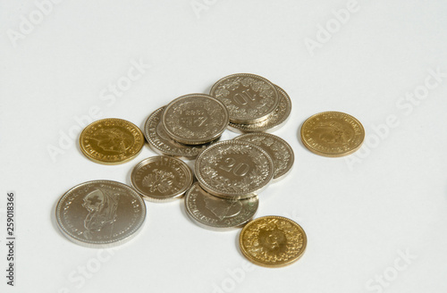 Valokuva  Swiss franc. Coins on white background.