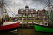 canvas print picture - Der Hafen von Neuharlingersiel mit zwei alten Fischkuttern