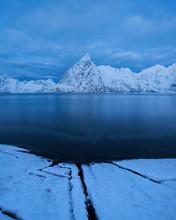 Olstind Mountai Peak Rises Out Of Reinefjord, Toppøy, Moskenesøy, Lofoten Islands, Norway