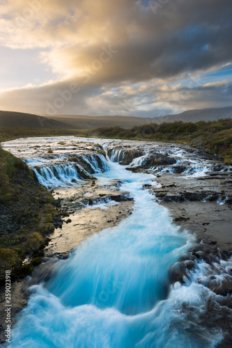 A unique waterfall known as Brúarfoss in Iceland.  - 259023918