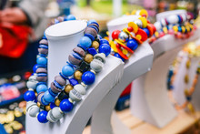 Big Beads On A Mannequin. Bright Feminine Decoration In Blue And White. Selling Colorful Necklaces On The Counter
