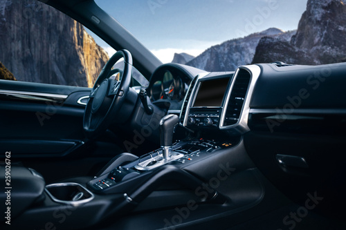 Obraz na plátně Expensive car interior with stearing wheel, multimedia and gearbox handle