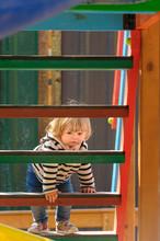 Cute Little Toddler Girl Climb...