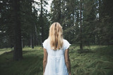 Fototapeta Las - White dressed woman, alone in magic forest.