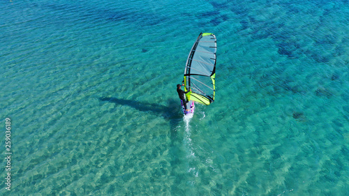 Aerial drone photo of Wind surfer practising in tropical exotic open ocean desti Fotobehang
