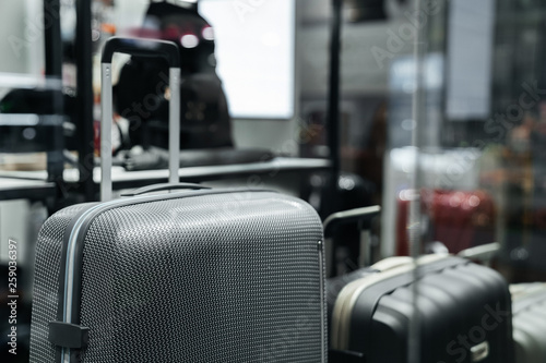 Fotografie, Obraz  Gray stylish suitcase for travel in a shop window.